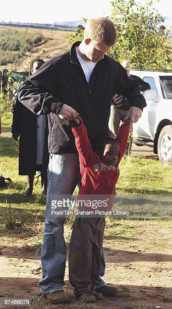 Prince Harry stands with his old friend, Mutsu Potsane, in the grounds of the Mants'ase children's home, while on a return visit to Lesotho in...