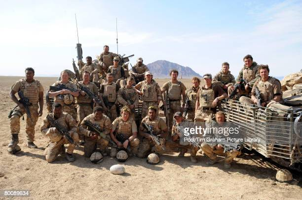 Prince Harry stands with soldiers in his battle group as they pose for a photograph in Helmand province on February 19 2008 in Southern Afghanistan