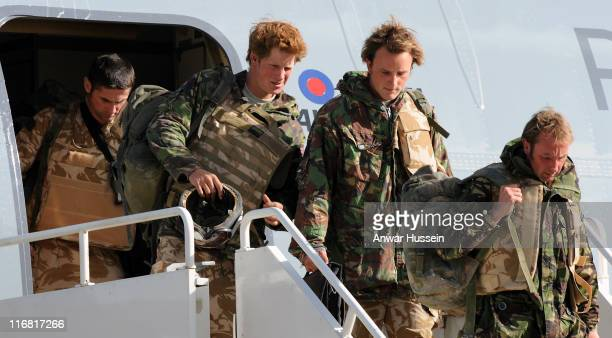 Prince Harry steps off a plane at RAF Brize Norton as he returns from Afghanistan on March 1 2008 in Brize Norton England