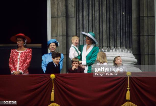 Prince Harry sticking his tongue out much to the suprise of his mother Princess Diana at Trooping The Colour with Prince William Lady Gabriella...