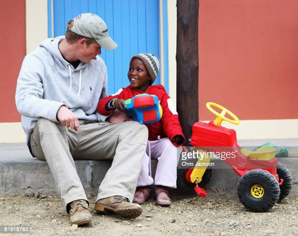 Prince Harry sticks his tounge out as he plays with Molise aged four during a visit to LCCU on July 9 2008 in Maseru Lesotho Prince Harry and 26...