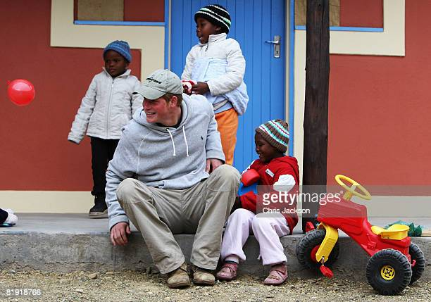 Prince Harry sticks his tounge out as he plays with Molise, aged four, during a visit to LCCU on July 9, 2008 in Maseru, Lesotho. Prince Harry and 26...