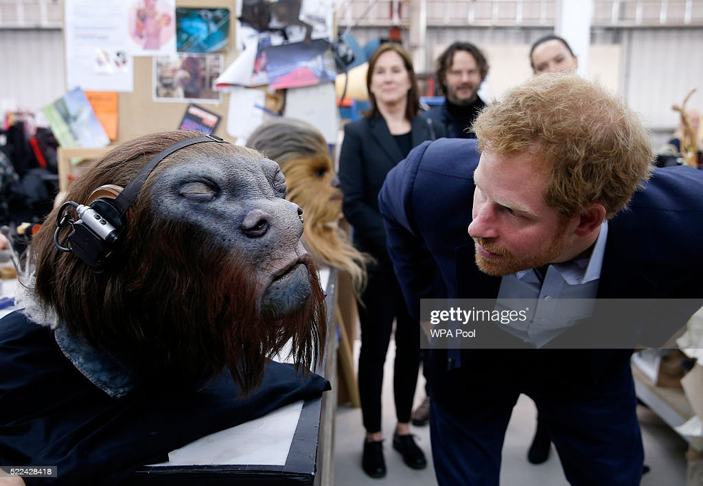 Prince Harry takes a closer look at a robotic mask during a tour of the Star Wars sets at Pinewood studios on April 19, 2016 in Iver Heath, England. Prince William and Prince Harry are touring Pinewood studios to visit the production workshops and meet the creative teams working behind the scenes on the Star Wars films.