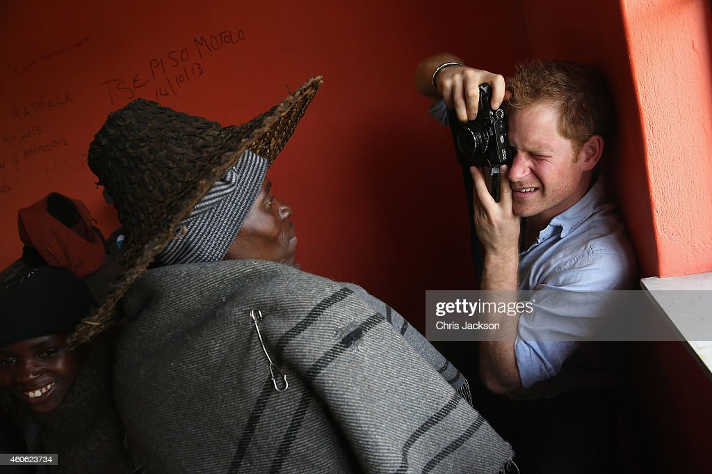 Prince Harry takes a photograph on a Fuji X100s Camera during a visit to a herd boy night school constructed by Sentebale on December 8, 2014 in Mokhotlong, Lesotho. Prince Harry was visiting Lesotho to see the work of his charity Sentebale. Sentebale provides healthcare and education to vulnerable children in Lesotho, Southern Africa. Speaking of the opportunity to document the visit himself, Prince Harry said: 'I have always enjoyed photography and the challenges that come with trying to capture the perfect shot, although privately I don't take many photos. The best photos I have are in my head - I have some very special memories, mostly from Africa. But on this visit, I had the time and opportunity to be on the other side of the camera and take some photos in the stunning country of Lesotho for my charity Sentebale.'