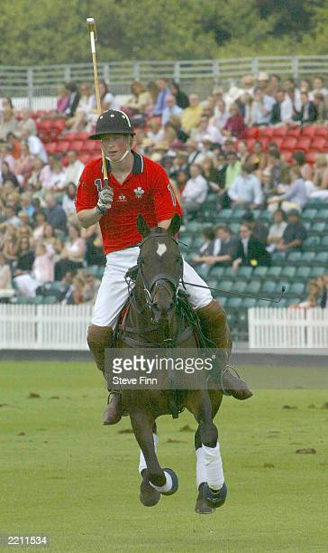 Prince Harry takes part at the Cartier polo in Windsor Great park Berkshire England on July 27 2003