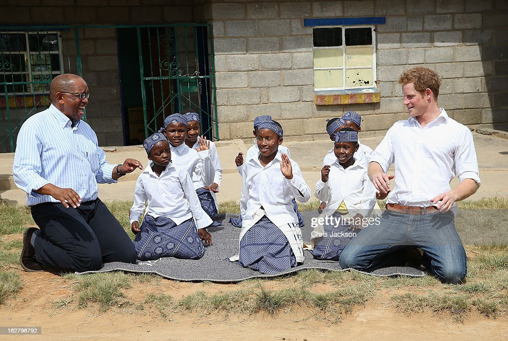 Prince Harry takes part in a dance as he visits the Kananelo Centre for the deaf, a project supported by his charity Sentebale on February 27, 2013 in Maseru, Lesotho. Sentebale is a charity founded by Prince Harry and Prince Seeiso of Lesotho. It helps the most vulnerable children in Lesotho get the support they need to lead healthy and productive lives. Sentebale works with local grassroots organisations to help these children, the victims of extreme poverty and Lesotho's HIV/AIDS epidemic. Cathy Ferrier was appointed as Sentebale's Chief Executive in March 2012 and is spearheading a fundraising initiative to build the Mamohato Centre which will provide psychosocial support for children and young people infected with HIV. Prince Harry is due to pay a visit to Lesotho this week to catch up on his charity's progress and meet key children who will be supported by the charity.