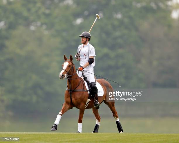 Prince Harry takes part in Audi Polo Challenge at Coworth Park Polo Club on May 6 2017 in Ascot England