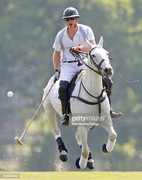 Prince Harry takes part in the Audi Polo Challenge at Coworth Park Polo Club on May 29 2016 in Ascot England