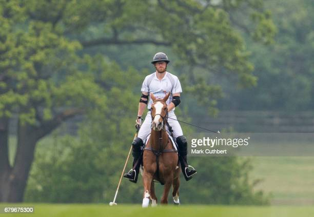 Prince Harry takes part in the Audi Polo Challenge at Coworth Park Polo Club on May 6 2017 in Ascot England