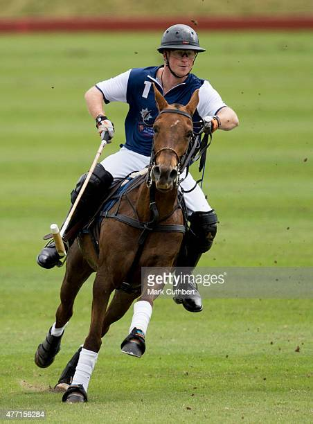 Prince Harry takes part in the Gigaset Charity Polo Match at Beaufort Polo Club on June 14 2015 in Tetbury England