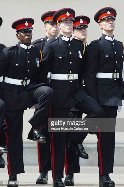 Prince Harry takes part in the Trooping Of New Colours alongside his fellow officer cadets at the Royal Military Academy, Sandhurst on June 21, 2005...