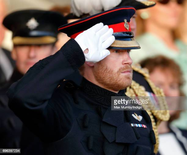 Prince Harry takes the salute as he attends The Household Division's Beating Retreat at Horse Guards Parade on June 15 2017 in London England Beating...