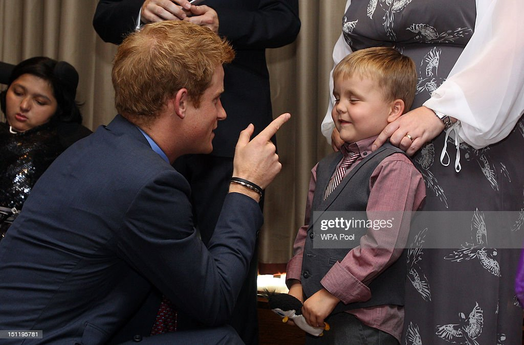 Prince Harry talks to Alex Logan as he attends the WellChild Awards at the Intercontinental Hotel on September 3, 2012 in London, England.