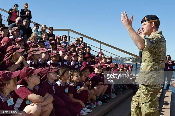 Prince Harry talks to children from St Marys South Public school during a visit to the Sydney Opera House on May 7 2015 in Sydney Australia Prince...