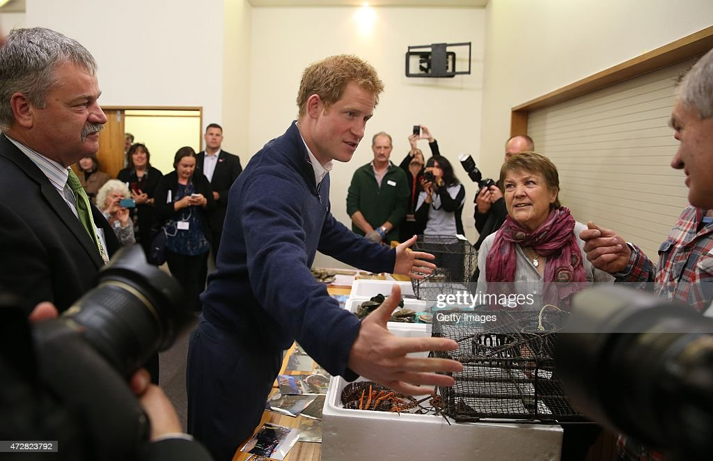 Prince Harry talks to fishermen and staff Southland District Mayor Gary Tong, Helen Cave, Heath Allan, and Colin Hopkins at the Southern Seafoods stall as he visits the Stewart Island Community Centre as part of his first visit to New Zealand on May 10, 2015 in Oban, New Zealand. Prince Harry is in New Zealand from May 9 through to May 16 attending events in Wellington, Invercargill, Stewart Island, Christchurch, Linton, Whanganui and Auckland.