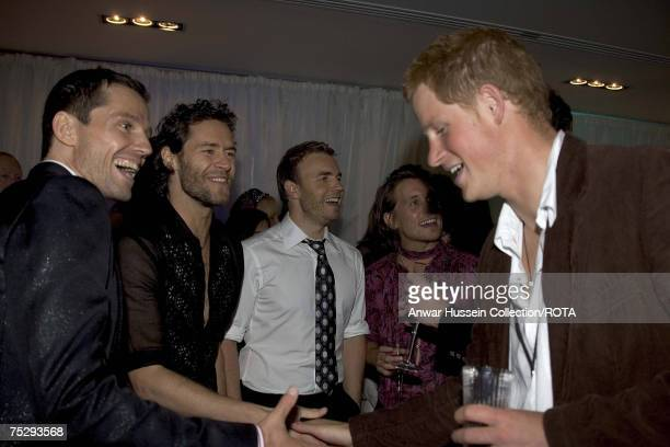 Prince Harry talks to Jason Orange and Howard Donald of Take that at the Concert for Diana After Party at Wembley Stadium on July 1 2007 in London...
