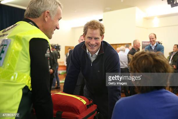 Prince Harry talks to Phil Dove a St Johns volunteer and Deborah Dillon at the Health Clinic stall visits the Stewart Island Community Centre as part...