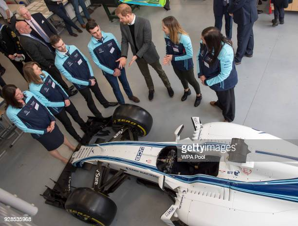 Prince Harry talks to staff from the Williams Racing team during his visit to the Silverstone University Technical College at Silverstone Circuit on...