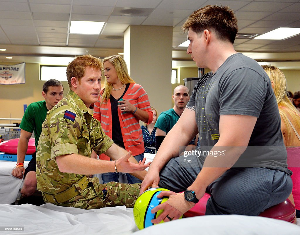 Prince Harry talks to staff Sergeant Timothy Payne (R) during his visit to the Military Advanced Training Center at Walter Reed National Military Medical Center treating wounded soldiers undergoing physical therapy on May 10, 2013 in Bethesda, Maryland. HRH will be undertaking engagements on behalf of charities with which the Prince is closely associated on behalf also of HM Government, with a central theme of supporting injured service personnel from the UK and US forces.