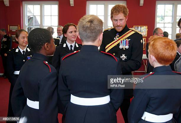 Prince Harry talks to students at an informal reception during his visit to The Duke of York's Royal Military School on September 28 2015 in Dover...