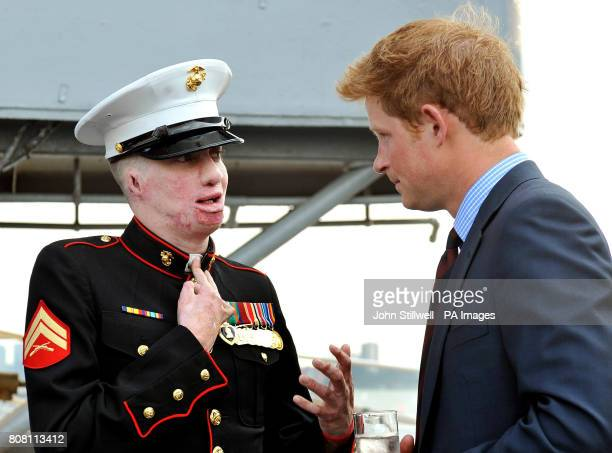 Prince Harry talks to US Marine Aaron Mankin who was injured in Iraq aboard the USS Intrepid an Aircraft carrier built in 1943 and now a Museum in...