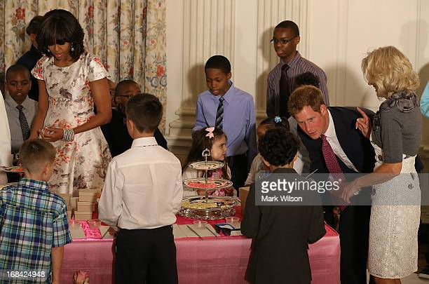 Prince Harry talks to young children during an event hosted by first lady Michelle Obama to honor military families at the White House on May 9 2013...