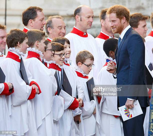 Prince Harry talks with choir boys as he attends the Commonwealth Observance Day Service at Westminster Abbey on March 14 2016 in London England The...