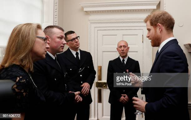 Prince Harry talks with Metropolitan Police officers as he and Prince William Duke of Cambridge host the winners of The Met Excellence Awards at...