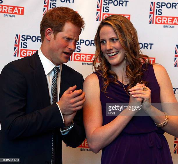 Prince Harry talks with Olympic gold medalist Missy Franklin at a reception at the Sanctuary Golf Course on May 10 2013 in Sedalia Colorado HRH will...