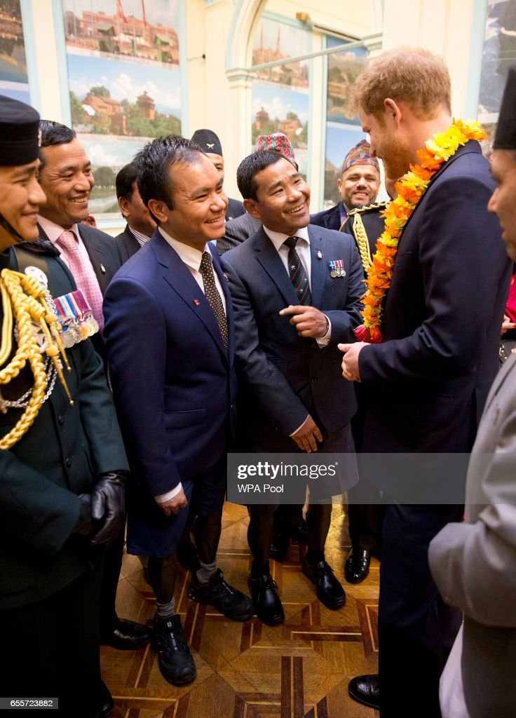 Prince Harry talks with two Gurkhas who he served with in Afghanistan (L-R) Rifleman Vinod Budhathoki, 32, and Corporal Hair Budha Magar, 37, as he attends a ceremony to celebrate the bicentenary of relations between the UK and Nepal at Embassy of Nepal on March 20, 2017 in London, England. Both Gurkhas were badly injured in Afghanistan both losing their legs.