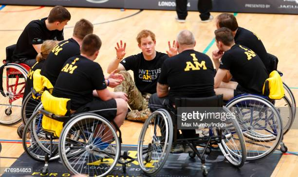 Prince Harry talks with wheelchair basketball players during the launch of the Invictus Games at the Copper Box Arena in the Queen Elizabeth Olympic...
