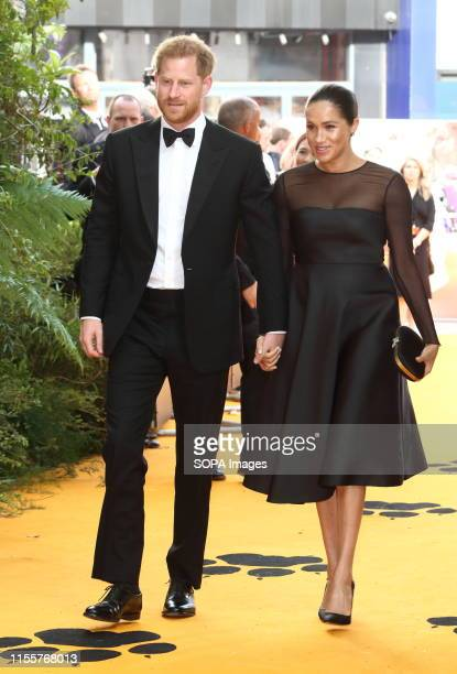 Prince Harry The Duke of Sussex and Meghan Duchess of Sussex attend the European Premiere of Disney's The Lion King at the Odeon Luxe cinema...
