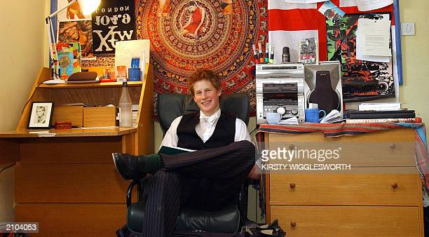 Prince Harry the younger son of the Prince of Wales sits 12 May 2003 in his room at Eton College Within limits students are allowed to decorate their...