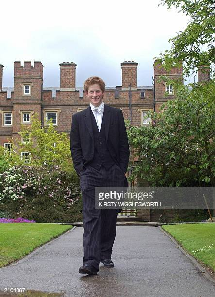 Prince Harry, the younger son of the Prince of Wales, who finishes his studies at Eton College later this month, walks 12 May 2003 in the College...