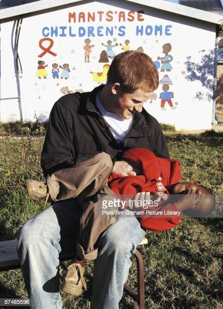 Prince Harry tickles his old friend, Mutsu Potsane, in the grounds of the Mants'ase children's home, while on a return visit to Lesotho in southern...