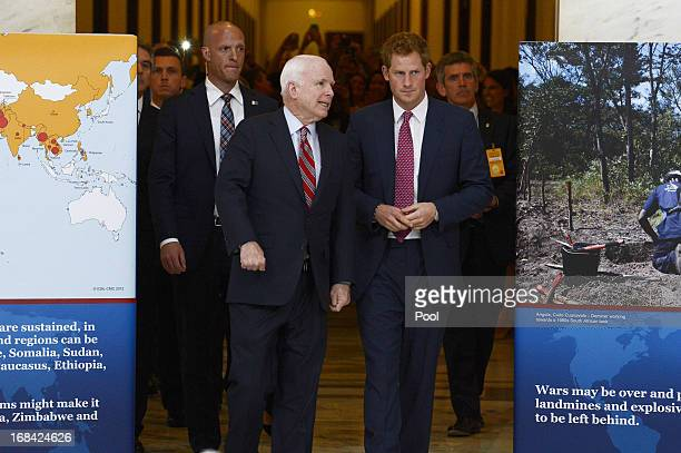 Prince Harry tours a HALO Trust photo exhibit on landmines and unexploded ordinances with Republican Senator from Arizona John McCain on Capitol Hill...