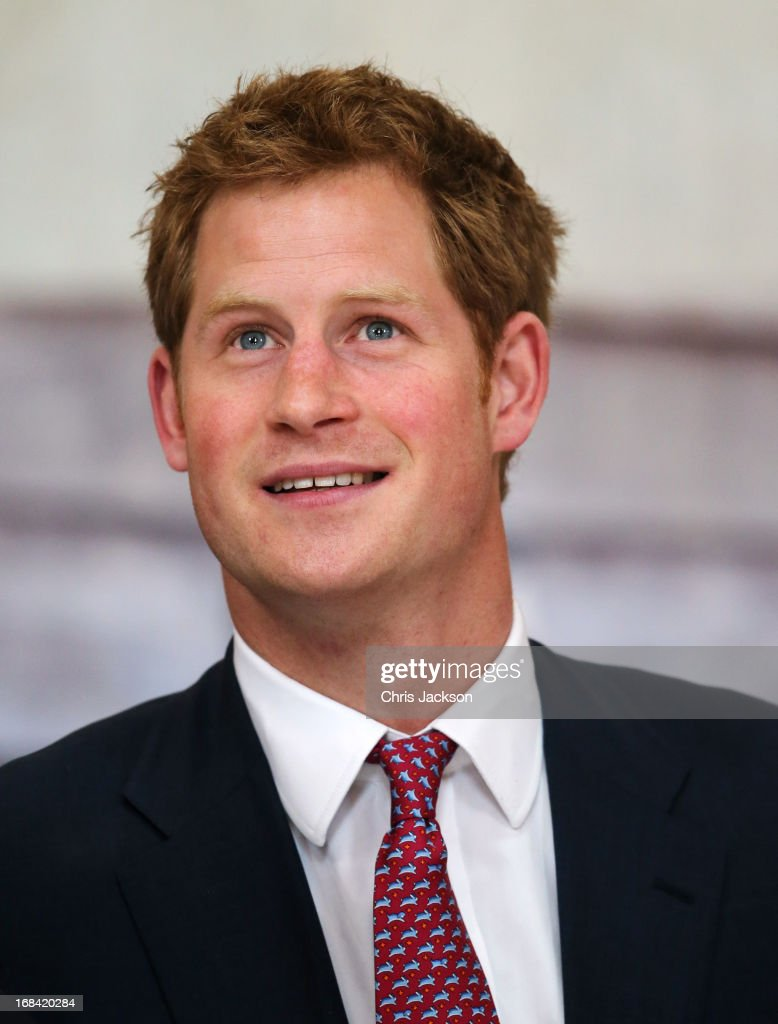 Prince Harry tours an anti-landmine photography exhibition by The HALO Trust charity during the first day of his visit to the United States at the Russell Senate Office Building on May 9, 2013 in Washington, DC. HRH will be undertaking engagements on behalf of charities with which the Prince is closely associated on behalf also of HM Government, with a central theme of supporting injured service personnel from the UK and US forces.