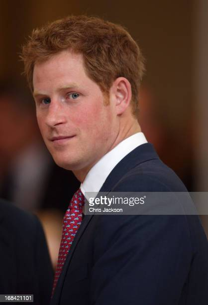 Prince Harry tours an anti-landmine photography exhibition by The HALO Trust charity during the first day of his visit to the United States at the...