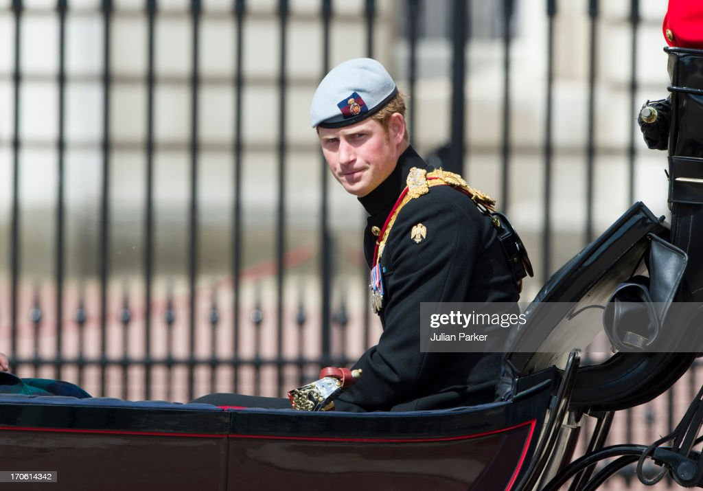 Prince Harry, travels by carriage to the annual Trooping The Colour ceremony at Horse Guards Parade on June 15, 2013 in London, England.