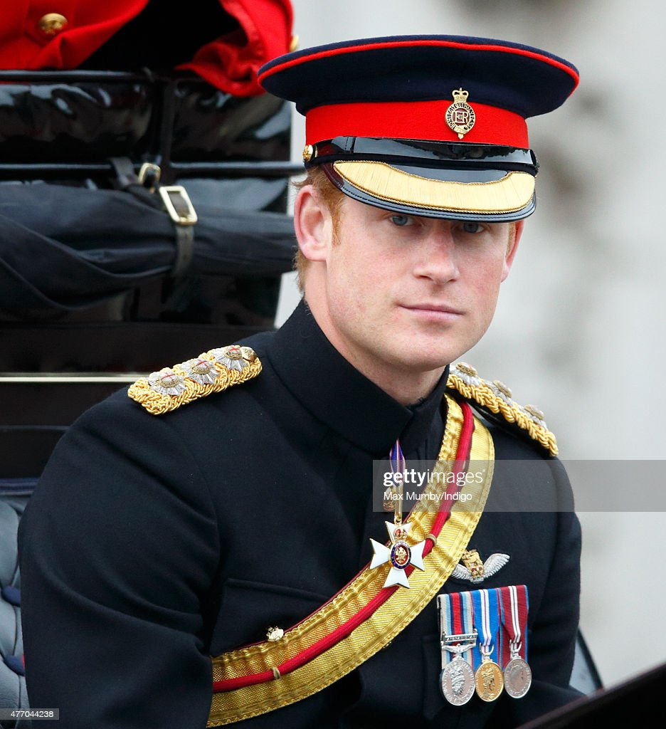 Prince Harry travels down The Mall in a horse drawn carriage during Trooping the Colour on June 13, 2015 in London, England. The ceremony is Queen Elizabeth II's annual birthday parade and dates back to the time of Charles II in the 17th Century, when the Colours of a regiment were used as a rallying point in battle.