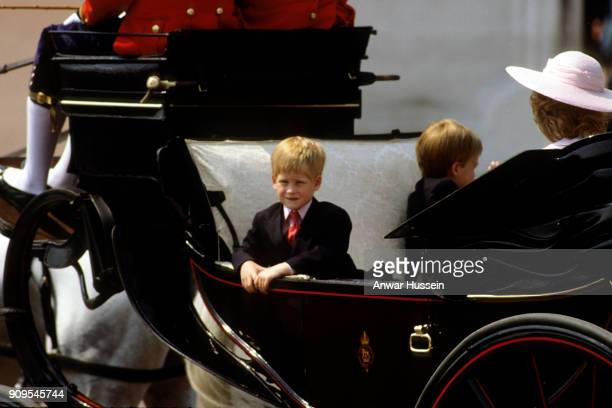 Prince Harry travels in an open carriage with Diana Princess of Wales Queen Elizabeth the Queen Mother and Prince William during Trooping the Colour...