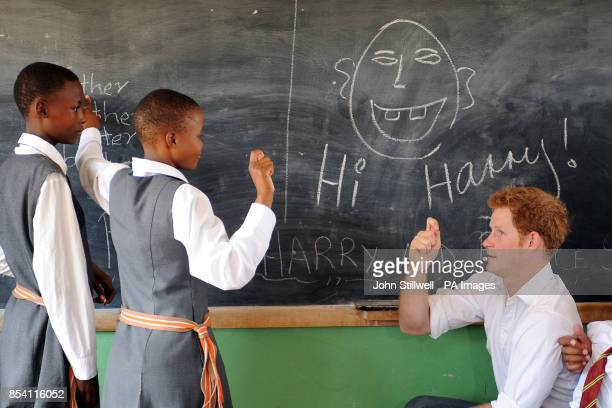 Prince Harry tries his hand at sign language in a class at the Kananelo Centre for the Deaf, in the Maseru district of Lesotho.