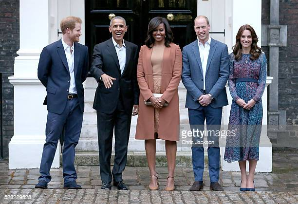 Prince Harry US President Barack Obama First Lady Michelle Obama Prince William Duke of Cambridge and Catherine Duchess of Cambridge pose as they...
