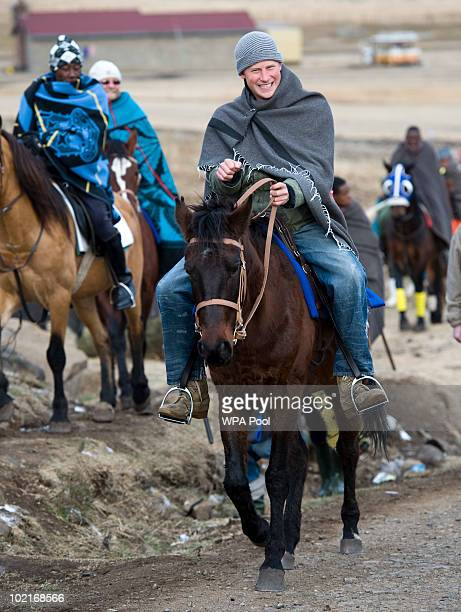 Prince Harry visiting The Herd Boys School rides a horse through the village accompanied by Prince Seeiso on June 16 2010 in Semongkong in Lesotho...