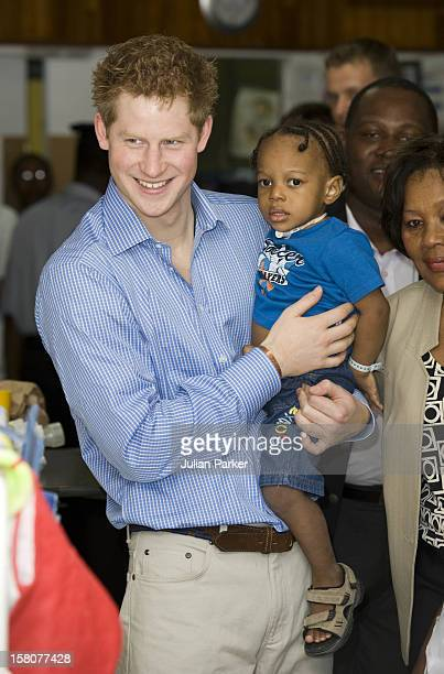 Prince Harry Visiting The Queen Elizabeth Ii Hospital In Bridgetown, Barbados, Visited The Children'S Ward And Met A Number Of Children.Seen Holding...