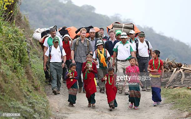 Prince Harry visits the village of Leorani in the Himalayan foothills on day three of his visit to Nepal on March 21 2016 in Bardia Nepal Prince...