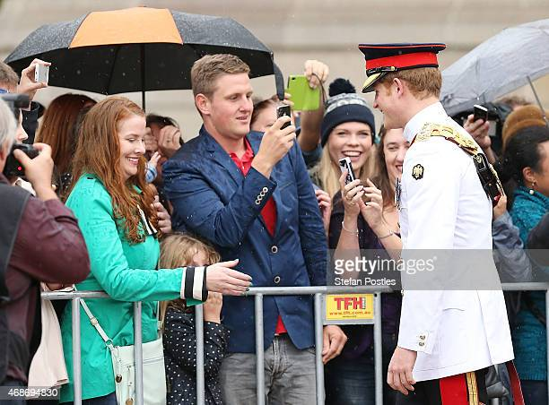 Prince Harry visits with members of the public outside the Australian War Memorial on April 6 2015 in Canberra Australia Prince Harry or Captain...