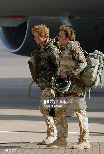 Prince Harry walks across the tarmac at RAF Brize Norton as he returns from Afghanistan on March 1 2008 in Brize Norton England