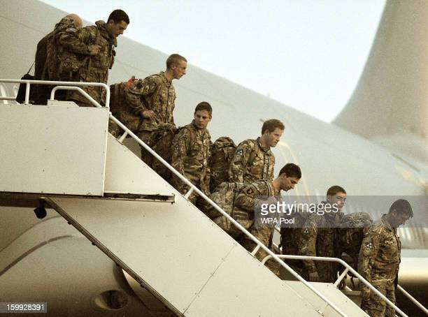 Prince Harry walks down the steps of a Royal Air Force A330 transport aircraft as he arrives at RAF Brize Norton on January 23 2013 in Oxfordshire...
