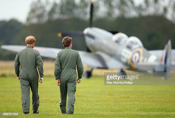 Prince Harry walks on the airfield at Goodwood Aerodrome as he is shown Spitfire Aircraft that will take place in a Battle of Britain Flypast at...